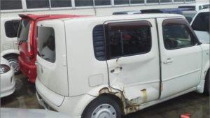 西条市で事故車買取したキューブのリア側画像